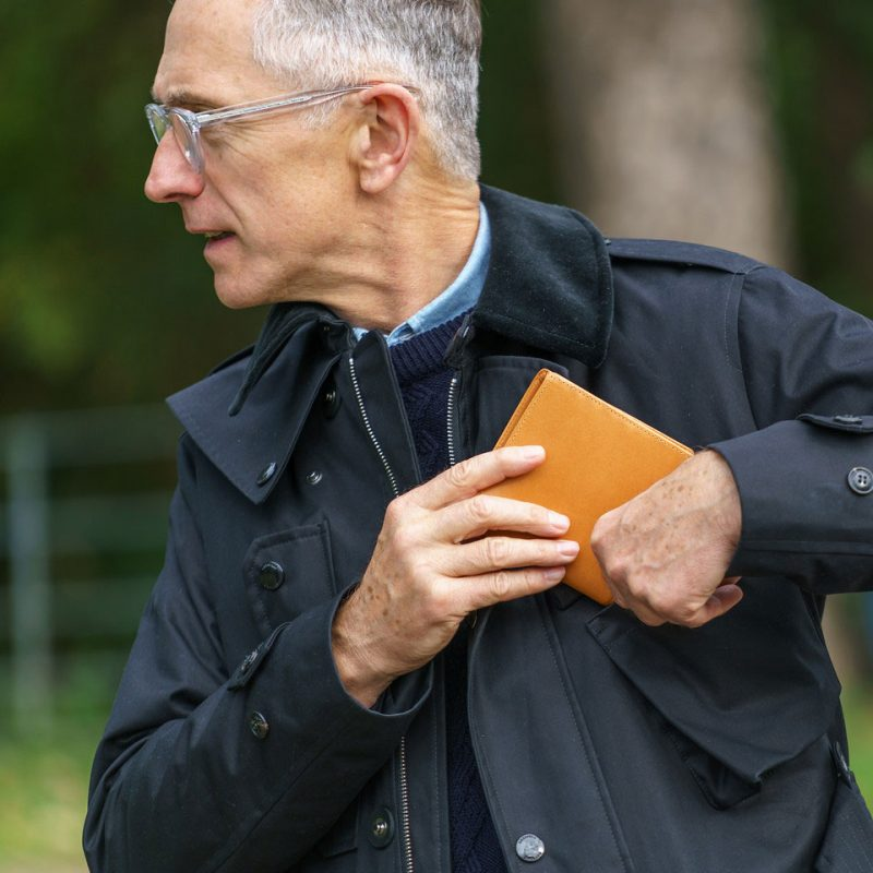 David Evans of the grey fox blog tucking a whitehouse cox wallet into his Grenfell jacket both made in england items